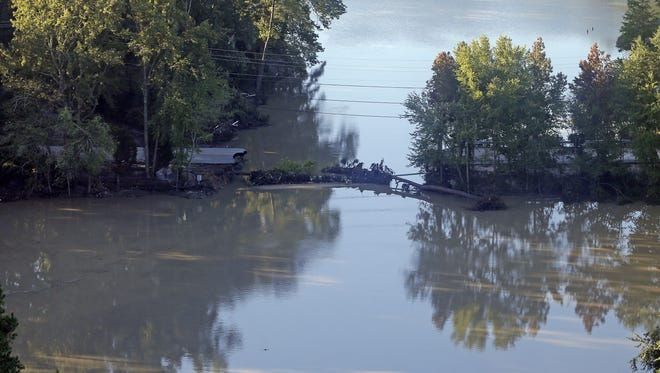 Chuck Burton/AP A road seen Tuesday is washed out from flooding in Columbia, S.C. Despite an improving forecast, it will still take weeks for the state to return to normal after being pummeled by a historic rainstorm. A road is washed out from flooding in Columbia, S.C., Tuesday, Oct. 6, 2015.  Despite an improving forecast, it will still take weeks for the state to return to normal after being pummeled by an historic rainstorm. (AP Photo/Chuck Burton)