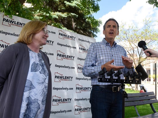 Former Gov. Tim Pawlenty announces that Lt. Gov. Michelle Fischbach will be his running mate during a press conference Thursday, May 31, near the Stearns County Courthouse in St. Cloud.