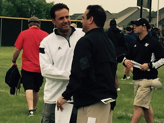 "Jedd Fisch works during the Sound Mind Sound Body camp on June 12. ""Jedd can work with anybody because he's a smart guy,"" former NFL coach Mike Shanahan said. ""With his personality, he gets along with everybody."""