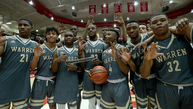 The Warren Central Warriors celebrate their win over the Terre Haute South Braves  in their 4A regional championship game at Southport High School on Saturday, March 10, 2018. The Warren Central Warriors defeated the Terre Haute South Braves 83-48.