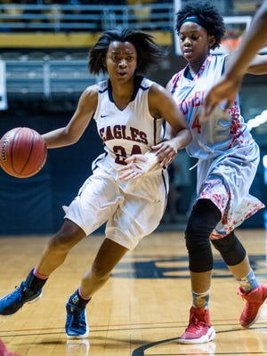 Montgomery Academy's Jade Brooks (24) drives against Midfield's Keenan Isaac at the AHSAA Regional Basketball Championships in Montgomery, Ala. on Wednesday February 22, 2017.