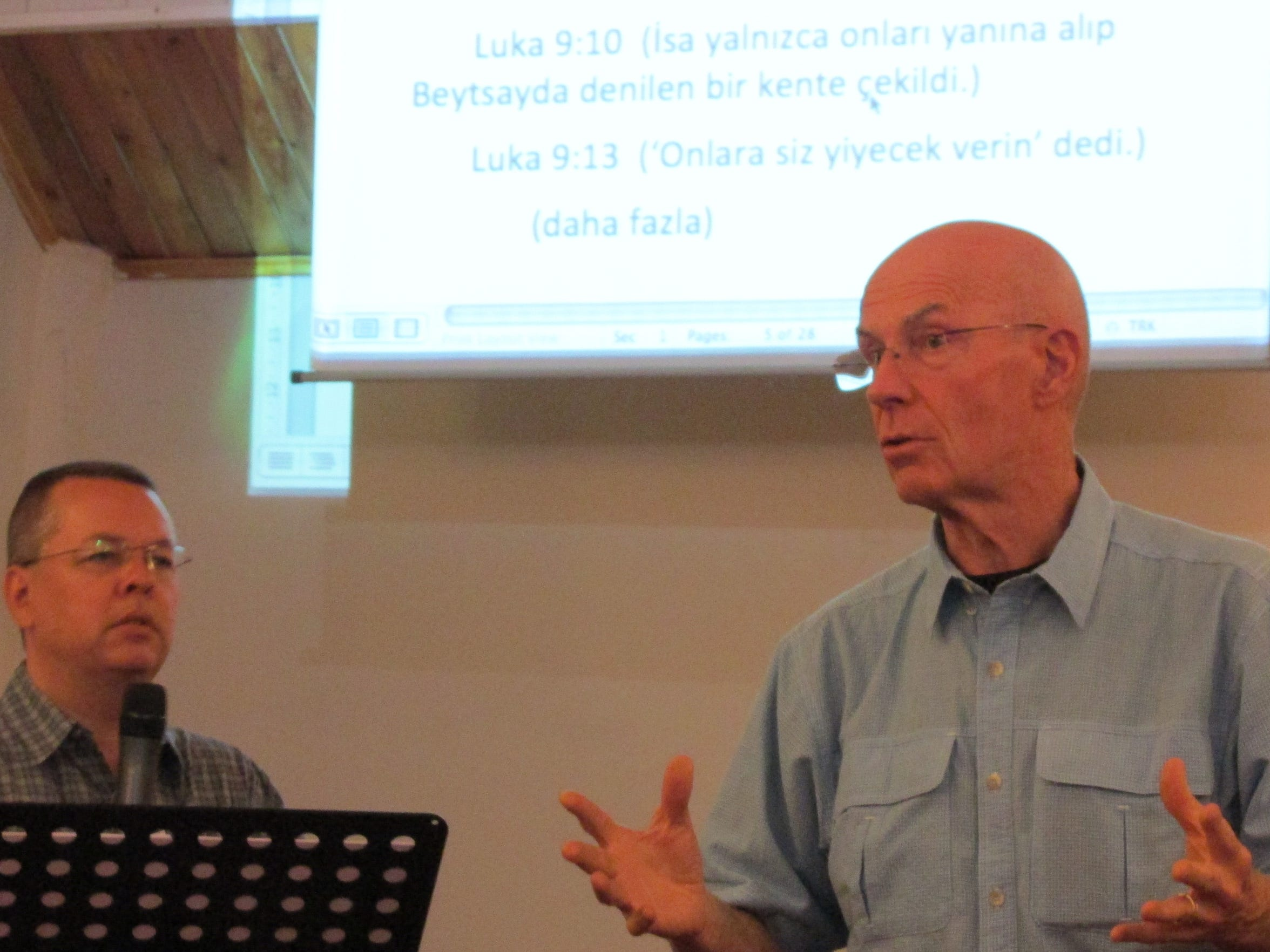 The Rev. Andrew Brunson, left, translates, as John Sullivan speaks at Resurrection Church in Izmir, Turkey, in 2014. Sullivan was one of eight members of Christ Community Church in Montreat who visited Izmir in 2014.