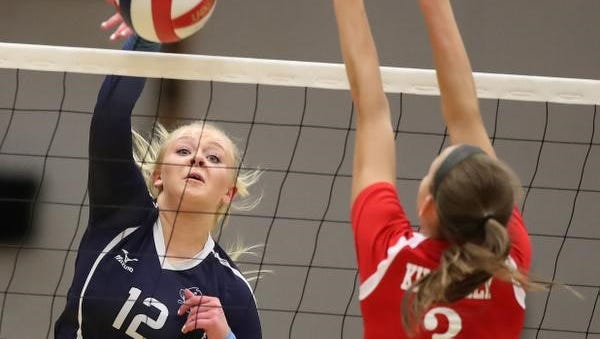 Bay Port's Olivia Schaut hits against Kimberly's  Courtney Pearson on Thursday in a WIAA Division 1 girls volleyball sectional semifinal at Ashwaubenon High School.
