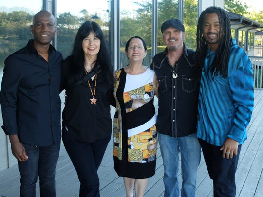 At the welcome reception for UT's Joy Harjo are Goffrey Moore, Joy Harjo, Marilyn Kallet, Judd Fuller and Tony James.