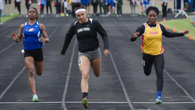 A new bill would let chiropractors do sports physicals for student athletes like Wauwatosa West senior Cheri'A Adams (center), who won the girls 100 meters last month ahead of Wisconsin Lutheran freshman Trinity Moore and DSHA senior Yaya Stallworth (right) at a WIAA Division 1 regional track and field meet at Wisconsin Lutheran High School.