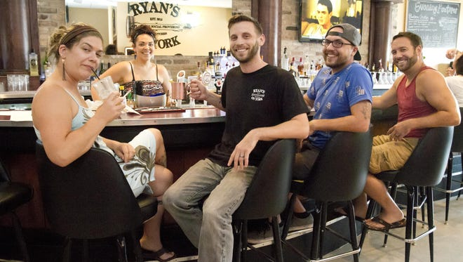 Ryan's on York owner Ryan Morris, center, poses with, from left, Shannon Hollahan, Jen Both, Djason Waterfalls and Dale Griffin at the pub on Friday, Aug. 14 in Manitowoc.