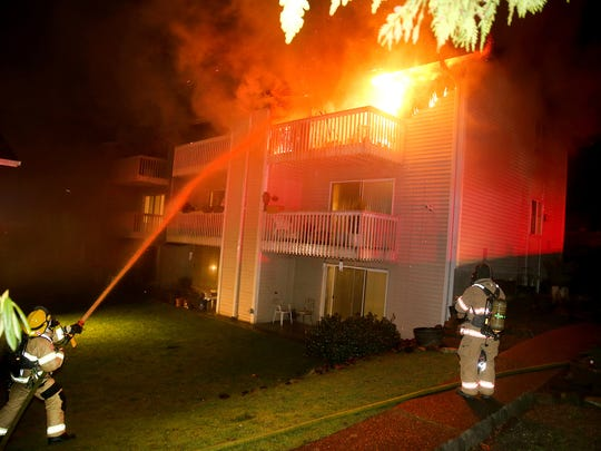 Firefighters battle a fire Tuesday night at the Edgewood