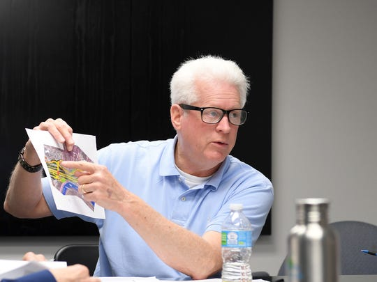 Ken Putnam, director of the city transportation department, talks about proposed plans during a meeting of the I-26 Connector Project Working Group at City Hall Friday.