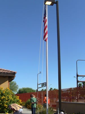 The flag flies. After taking on the HOA and winning, Kyle Tucker raises Old Glory for the first time at the Arizona Agribusiness and Equine Center.
