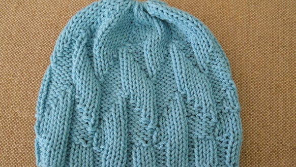 Robin Celli designed this Waves of hope hat, which