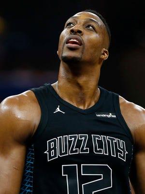 Charlotte Hornets center Dwight Howard looks on against the Orlando Magic.