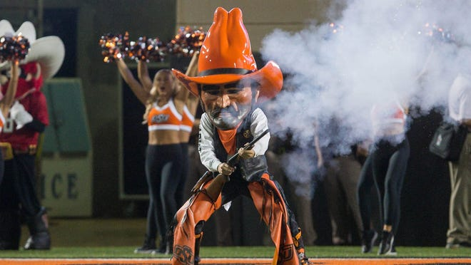 Sep 22, 2018; Stillwater, OK, USA;  Oklahoma State Cowboys mascot Pistol Pete fires his gun during a break in the action against the Texas Tech Red Raiders during the game at Boone Pickens Stadium. Texas Tech won the game 41-17. Mandatory Credit: Brett Rojo-USA TODAY Sports ORG XMIT: USATSI-382250 ORIG FILE ID:  20180922_jel_rb9_084.jpg