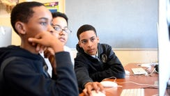 Rensford, left, Haziel and Axel continue brainstorming