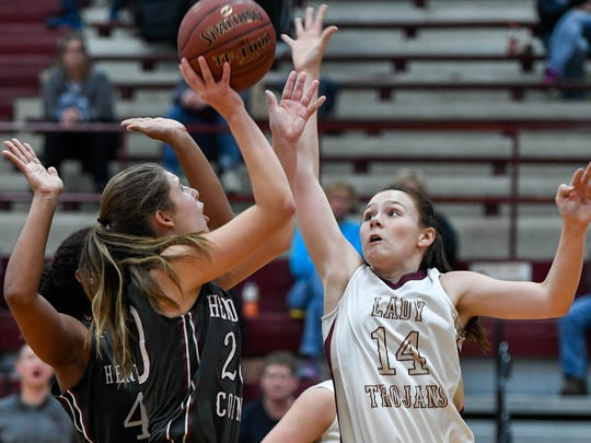 Henderson's Emma Lander shoots over Webster's Jamie Winstead as the Henderson County Lady Colonels plays district rival Webster County in Dixon Monday, January 23, 2017.