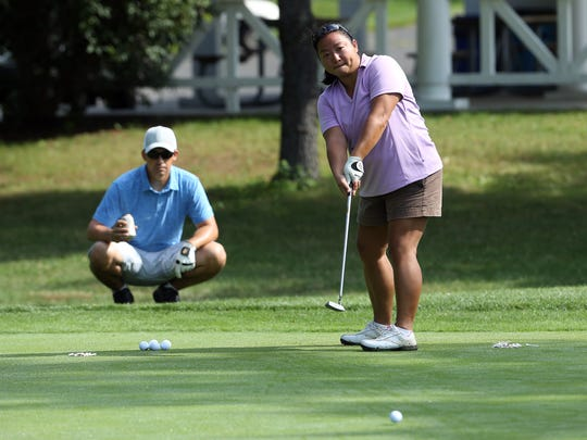 Glen Soria of New Providence looks on as Helen Wang of New Providence putts at the putting challenge during the WomanÕs Club of Parsippany-Troy Hills 35th Annual Tee Off for Education Golf Classic & Luncheon Social at  Knoll Country Club West. The Classic will raise funds to for the WCPTHÕS Scholarship and Education Fund. July 12, 2016, Parsippany, NJ