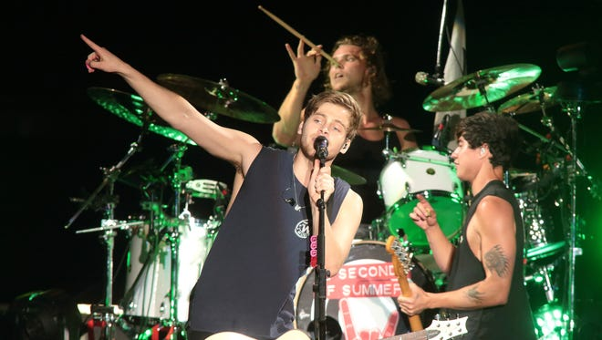 The band 5 Seconds of Summer performs during its Rock Out with Your Socks Out Tour 2015 at Hershey Stadium Saturday, Aug. 29 in Hershey, Pennsylvania.