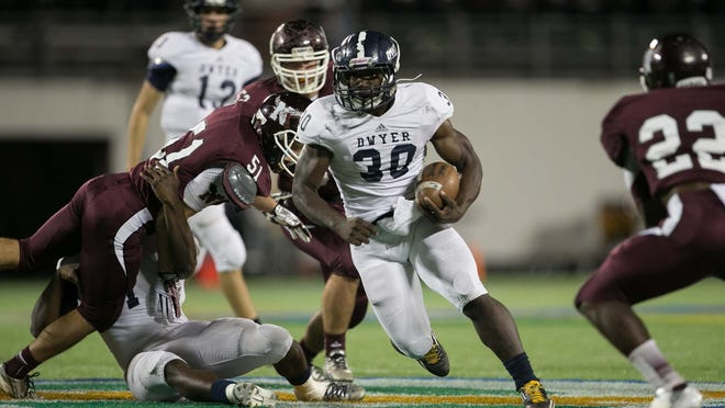 Gerald Hearns (No. 30) rushes for Dwyer against Niceville in Class 7A state championship game last year.