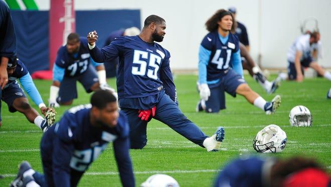 Zach Brown (55) stretches during Titans practice at Saint Thomas Sports Park in Nashville on May 26, 2015.