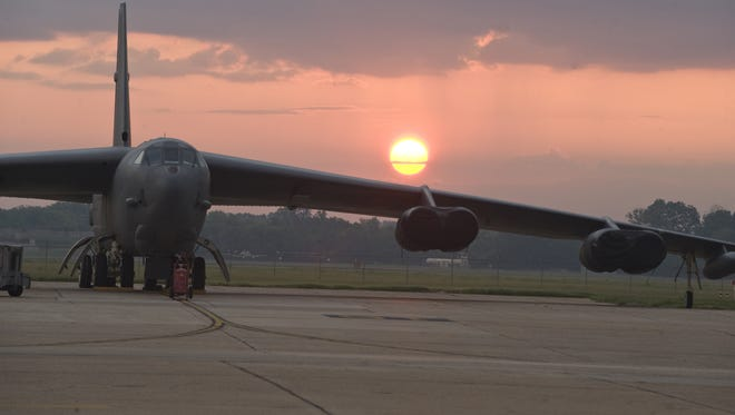 The sun rises behind a bomber at Barksdale Air Force Base.