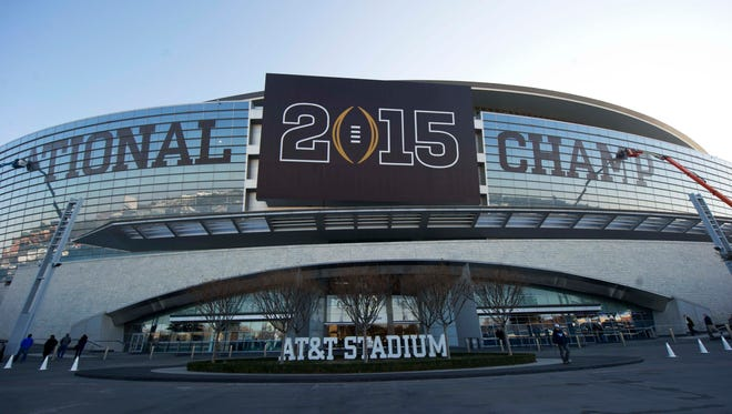 A general view of AT&T Stadium as signage is added on the exterior of the stadium.