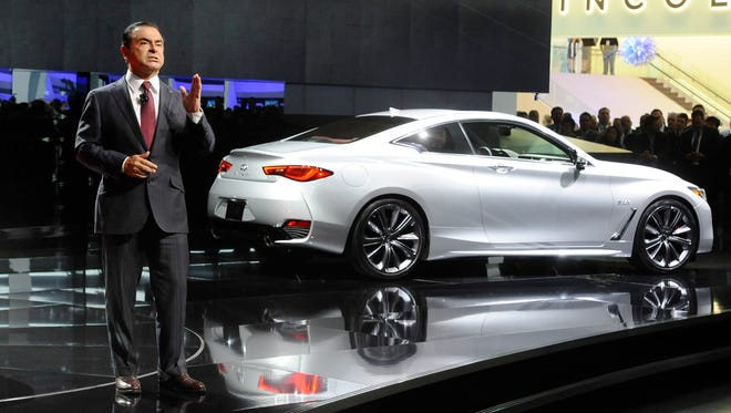Nissan Motor's chairman Carlos Ghosn, seen here introducing the Infiniti Q60, has been arrested and will be dismissed for alleged under-reporting of his income and misuse of company funds, the company said Monday.