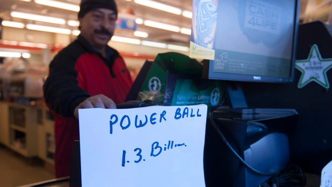 Vinod Kumar, owner of 7-11 on Cuthbert Blvd. in Haddon Twp., prints a Powerball ticket. Monday, January 11, 2016.