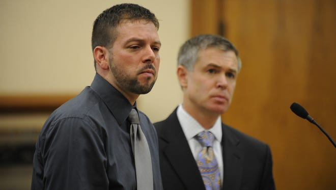 Former youth minister Chad Apsey, left, stands next to his attorney, Mike Nichols, in Clinton County Circuit Court during his sentencing hearing Monday. Apsey pleading guilty in February to a third-degree criminal sexual conduct in a case involving a girl younger than 16.