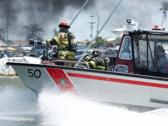 Fire crews race to put out a boat fire June 4 at Capri Marina.