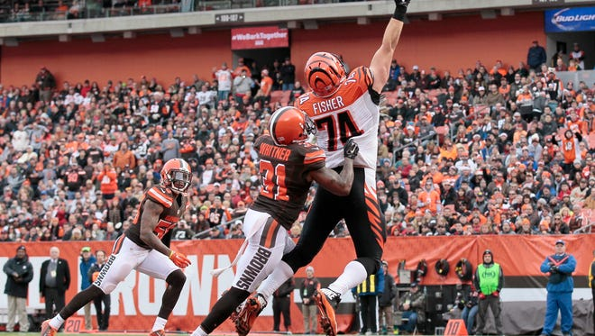 Cincinnati Bengals offensive tackle Jake Fisher (74) stretches for a pass but isn't able to come up with it in the end zone during the first quarter of the NFL Week 13 game between the Cleveland Browns and the Cincinnati Bengals at FirstEnergy Stadium in downtown Cleveland on Sunday, Dec. 6, 2015. At the half, the Bengals led 20-3.