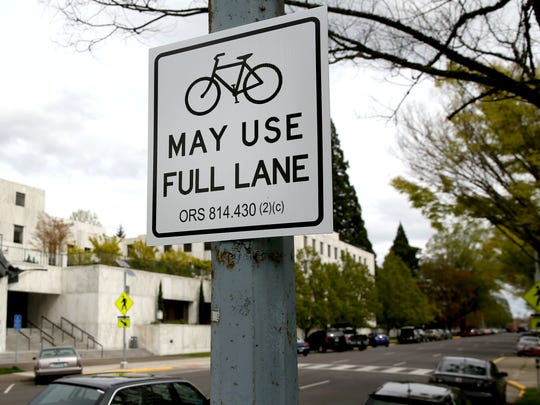 A sign greets motorist along State Street. Cyclist David Fox placed the sign on a light post to generate awareness of cyclist rights. Photo taken on Monday, April 6, 2015, in Salem, Ore.