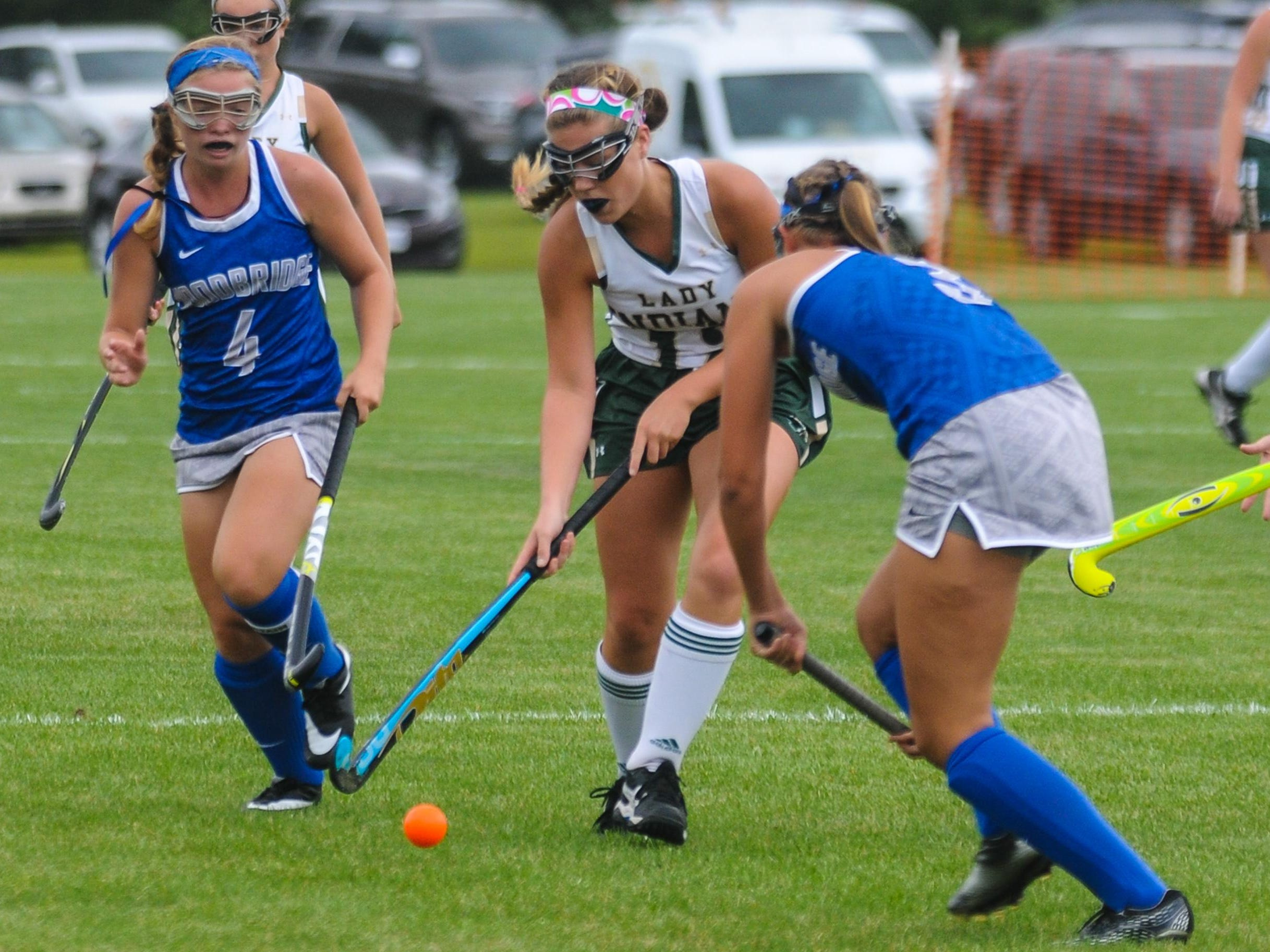 Indian River's Emma-Lee Merrickfights through the Woodbridge defense on Tuesday afternoon in Dagsboro.