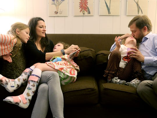 The Gieselmann family, from left, Ann Carlyle, Dana, Milla, Elle, and Frazer are show at their Memphis home in this file photo. Milla died from Batten disease in 2016. Elle also has Batten.