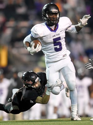 Maryville's Will Orren (4) stops Cane Ridge's Devon Starling (5) during the second half of the Class 6A state championship game at Tucker Stadium in Cookeville, Tenn., Friday, Dec. 1, 2017.
