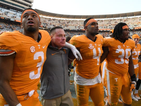Tennessee coach Butch Jones sings with his players, including Josh Malone (3), LaTroy Lewis (4) and Kendal Vickers (39) after the Vols' 49-36 win over Kentucky on Nov. 12, 2016.