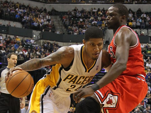 Paul George, left, and Luol Deng are specimens among many at the most athletic position in the NBA, small forward. USA TODAY Sports' Adi Joseph ranks the 15 best based on expectations for the 2013-14 season.