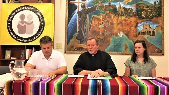 Dylan Corbett, from left, the Rev. Bob Mosher and Emily Bowen speak at a news conference Monday by the Detained Migrant Solidarity Committee regarding Operation Mega.