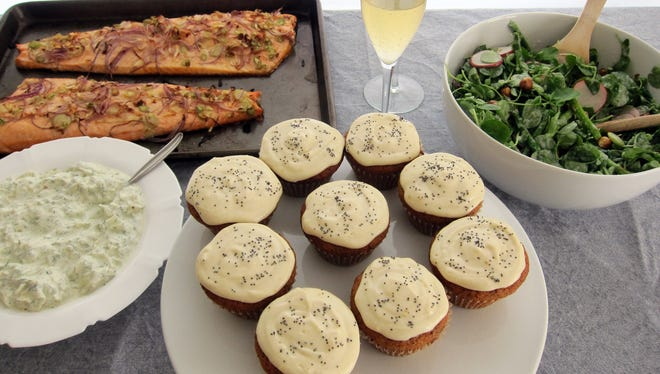 This spring brunch includes (clockwise from upper left): Roast salmon with fennel yogurt sauce, honey vanilla spritzers, spring salad with creamy yogurt dressing and mandarin poppy seed cupcakes.