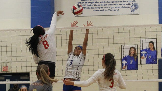 Lake View's Veronica Diaz (5) goes up for a block against Lubbock Coronado's Ayana Segrest Tuesday, Sept. 26, 2017, at Ben Norton Gym at Lake View..