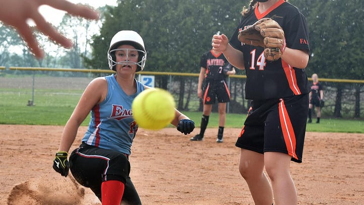 Southern Door's Erin Tadych scores on a wild pitch