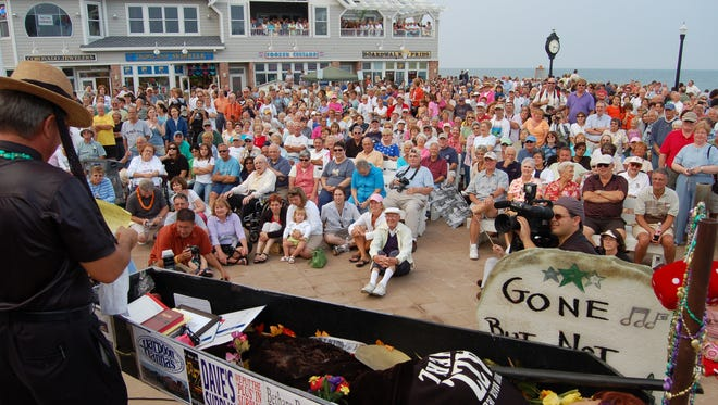 A casket with the mannequin of summer sits in front of a big audience at the Bethany Beach Bandstand  as part of the Bethany Beach Jazz Funeral. The event this year takes place Labor Day Monday, Sept. 4.