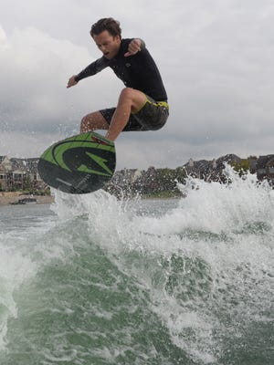 Nick Parros practices for the World Wake Surfing Championship on Hidden Lake in South Lyon
