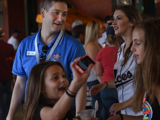 Reno Aces President Eric Edelstein, left, smiles after