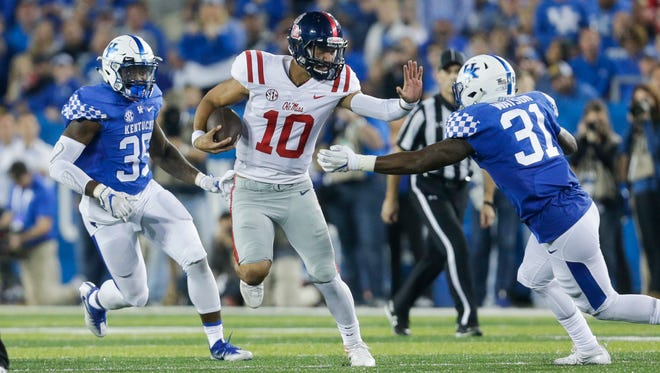 Jordan Ta'amu passed for 382 yards and four touchdowns and led Ole Miss on a game-winning drive in the final minutes Saturday.