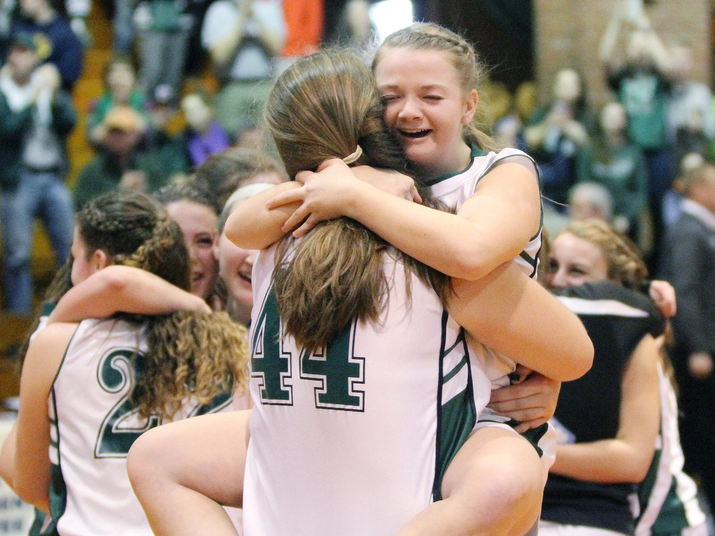 Mount St. Joseph's Olivia Corbett, right, hugs teammate Sally Hogan their 35-29 win over Proctor in the Division IV high school state championship game at Barre Auditorium on Saturday.