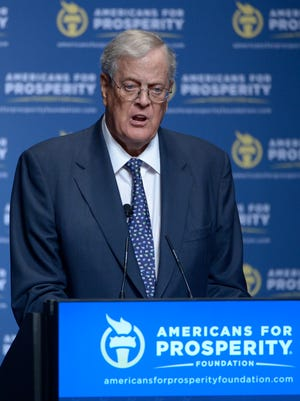 "David Koch addresses attendees of Americans for Prosperity's 2013 ""Defending the American Dream"" summit in Orlando."