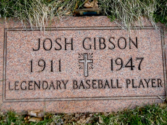 """In this photo made on Friday, March 17, 2017, the grave stone for baseball player Josh Gibson is shown at Allegheny Cemetery in Pittsburgh. Gibson, who played for two Negro League baseball teams in Pittsburgh and is considered one of the sport's greatest home run hitters, is featured in an opera about his life called """"The Summer King."""""""