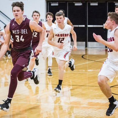 Wes-Del's Sutter Foster sprints up the court in a December