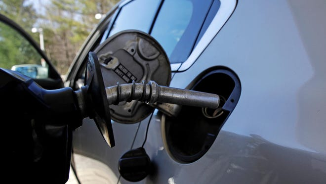 A car is filled with gasoline at a station in Windham, New Hampshire. Conserving oil is no longer an economic imperative for the U.S., the Trump administration declared recently in a major new policy statement.