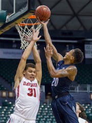 Akron guard Eric Parrish (20) shoots over Davidson guard Kellan Grady (31) during the Diamond Head Classic on Christmas Day, 2017.