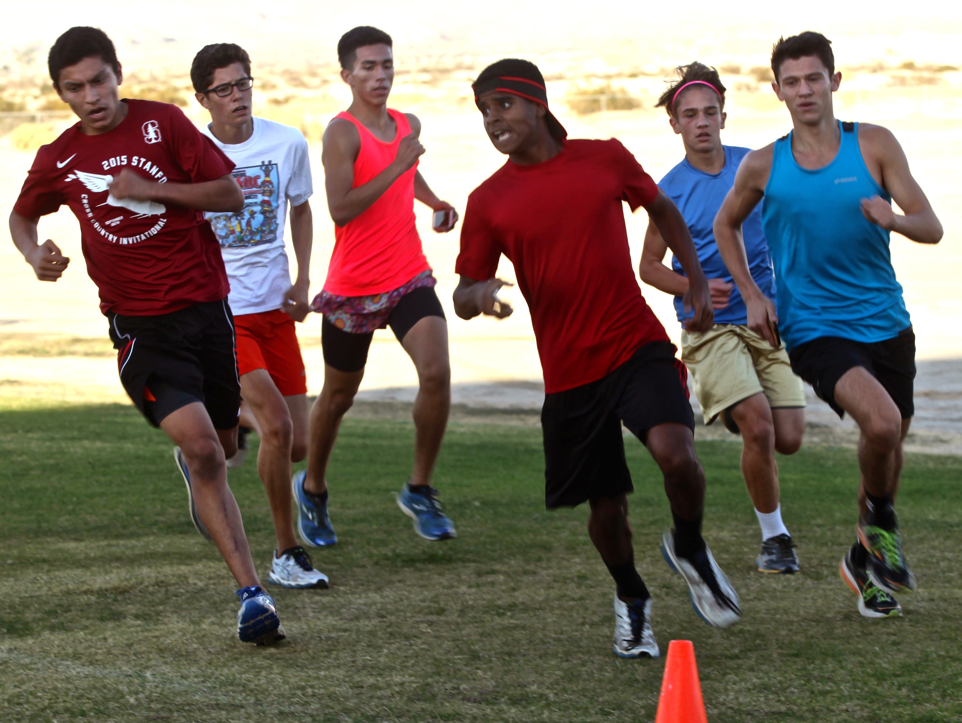 Students of the Xavier Prep cross country team run together during a practice session on Tuesday, Nov. 24, 2015.